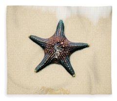 Starfish On The Beach Sand. Close Up. Fleece Blanket