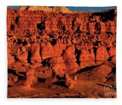 Sunset Light Turns The Hoodoos Blood Red In Goblin Valley State Park Utah Fleece Blanket
