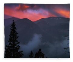 Fleece Blanket featuring the photograph Sunset Storms Over The Rockies by John De Bord