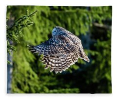 Ural Owl Flying In The Fir Forest With Sunshine On Its Back Fleece Blanket