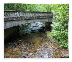 Water Flowing Beneath A Rustic Bridge Fleece Blanket