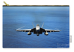 Carry-all Pouch featuring the photograph  A Fa-18 Hornet Demonstrates Air Power. by Paul Fearn