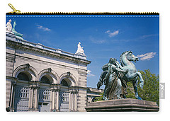Low Angle View Of A Statue In Front Carry-all Pouch by Panoramic Images