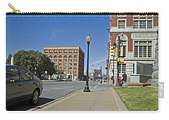 Carry-all Pouch featuring the photograph Texas School Book Depository by Charles Beeler