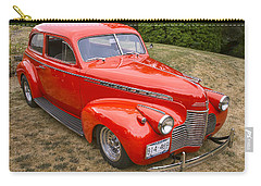 Carry-all Pouch featuring the photograph 1940 Chevrolet 2 Door Sedan by Peggy Collins