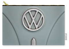 Carry-all Pouch featuring the photograph 1965 Volkswagen Beetle Hood Emblem by Jani Freimann