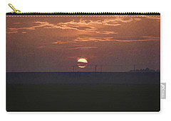 The Setting Sun In The Distance With Clouds Carry-all Pouch by Ashish Agarwal