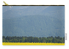 rapeseed field in Brnik with Kamnik Alps in the background Carry-all Pouch