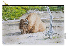 A Buffalo Sits In Yellowstone Carry-all Pouch by Michele Myers