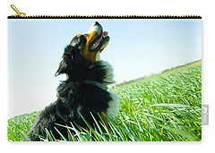 A Cute Dog On The Field Carry-all Pouch