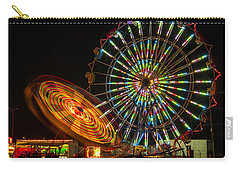 Carry-all Pouch featuring the photograph Colorful Carnival Ferris Wheel Ride At Night by Jerry Cowart