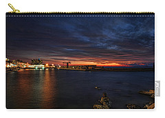 Carry-all Pouch featuring the photograph a flaming sunset at Tel Aviv port by Ron Shoshani