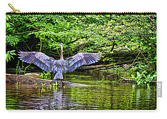 Carry-all Pouch featuring the photograph A Heron Touches Down by Eleanor Abramson