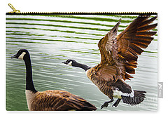 Carry-all Pouch featuring the photograph A Pair Of Canada Geese Landing On Rockland Lake by Jerry Cowart