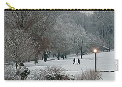 Carry-all Pouch featuring the photograph A Pair Of Evening Walkers In Winter by Gary Slawsky