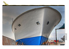 Carry-all Pouch featuring the photograph a resting boat in Jaffa port by Ron Shoshani