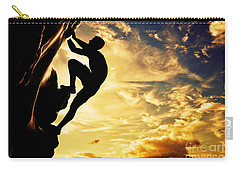 A Silhouette Of Man Free Climbing On Rock Mountain At Sunset Carry-all Pouch