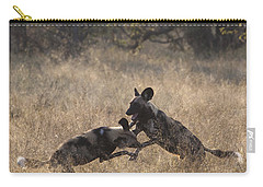 Carry-all Pouch featuring the photograph African Wild Dogs Play-fighting by Liz Leyden