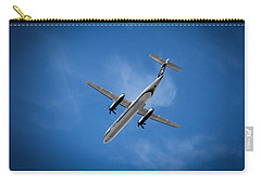 Flight Carry-all Pouch featuring the photograph Alaska Airlines Turboprop by Aaron Berg