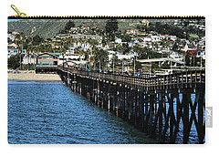 Carry-all Pouch featuring the photograph Along The Pier by Michael Gordon