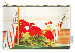 American Flags And Geraniums In A Wheelbarrow One Carry-all Pouch by Marian Cates