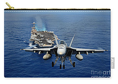 Carry-all Pouch featuring the photograph An Fa-18 Hornet Demonstrates Air Power. by Paul Fearn
