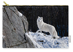 Carry-all Pouch featuring the photograph Arctic Wolf On Rock Cliff by Wolves Only