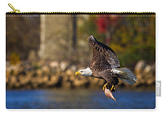 Bald Eagle In Flight Over Water Carrying A Fish Carry-all Pouch