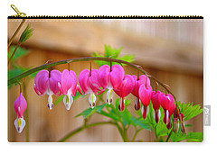 Carry-all Pouch featuring the photograph Graceful Arch Of Bleeding Heart by Patti Whitten