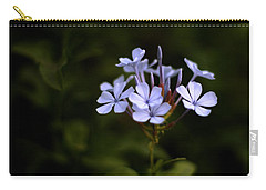 Carry-all Pouch featuring the photograph Blue Jasmine by Ramabhadran Thirupattur