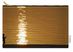 Boy Fishing At Sunset Carry-all Pouch by Charles Beeler