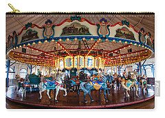 Carry-all Pouch featuring the photograph Carousel Ride by Jerry Cowart