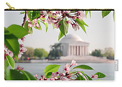 Carry-all Pouch featuring the photograph Cherry Blossoms And The Jefferson Memorial by Mitchell R Grosky