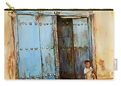 Child Sitting In Old Zanzibar Doorway Carry-all Pouch by Sher Nasser