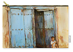 Carry-all Pouch featuring the painting Child Sitting In Old Zanzibar Doorway by Sher Nasser
