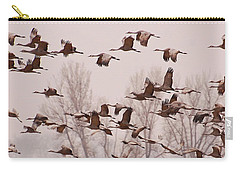Carry-all Pouch featuring the photograph Cranes Across The Sky by Don Schwartz