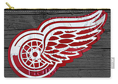 Detroit Red Wings Recycled Vintage Michigan License Plate Fan Art On Distressed Wood Carry-all Pouch by Design Turnpike