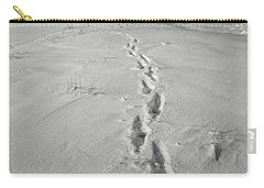 Footprints Leading From The Lighthouse Big Red During Winter Carry-all Pouch by Randall Nyhof