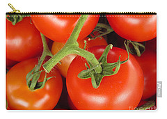 Carry-all Pouch featuring the photograph Fresh Whole Tomatos On Vine by David Millenheft