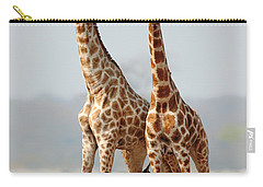Giraffes Standing Together Carry-all Pouch by Johan Swanepoel