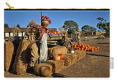 Carry-all Pouch featuring the photograph Guarding The Pumpkin Patch by Michael Gordon