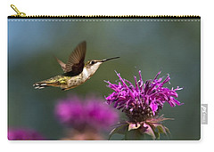 Carry-all Pouch featuring the photograph Hummingbird Moving Along by Christina Rollo