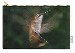 Carry-all Pouch featuring the photograph In Flight by Photographic Arts And Design Studio