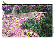Carry-all Pouch featuring the photograph Interior Decorations Butterfly Gardens Vegas Golden Yellow Purple Flowers by Navin Joshi