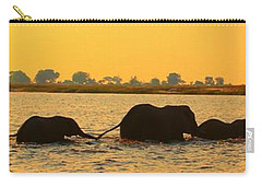 Carry-all Pouch featuring the photograph Kalahari Elephants Crossing Chobe River by Amanda Stadther