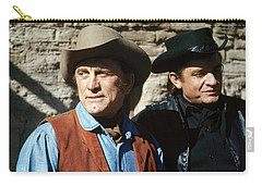 Carry-all Pouch featuring the photograph Kirk Douglas Johnny Cash A Gunfight  Old Tucson Arizona 1971 by David Lee Guss