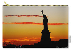 Carry-all Pouch featuring the photograph Lady Liberty At Sunset by Susan Wiedmann