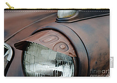 Carry-all Pouch featuring the photograph License Tag Eyebrow Headlight Cover  by Wilma  Birdwell