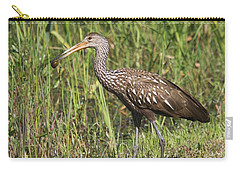 Carry-all Pouch featuring the photograph Limpkin With Apple Snail by Christiane Schulze Art And Photography