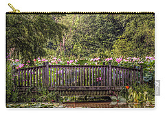 Carry-all Pouch featuring the photograph Lotus Garden Pond And Bridge by Jerry Gammon